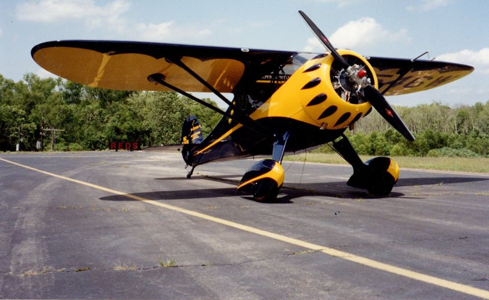 Red Lerille's Monocoupe 110 Special N546W in blue and yellow